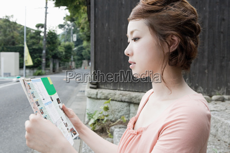 young woman looking at map