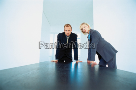 businessman and businesswoman in board room