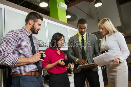 young business colleagues looking at digital