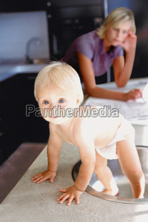 woman and infant in kitchen