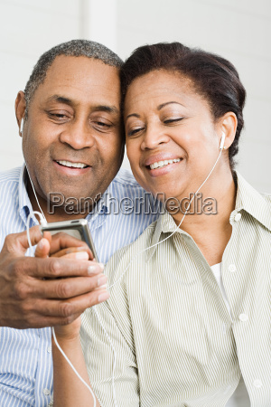 mature couple sharing mp3 player