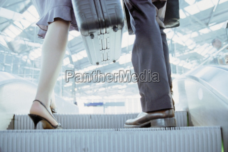 businessman and businesswoman on airport elevator
