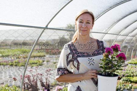 portrait of mature female customer holding