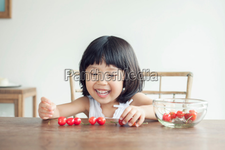 girl with bowl of cherries