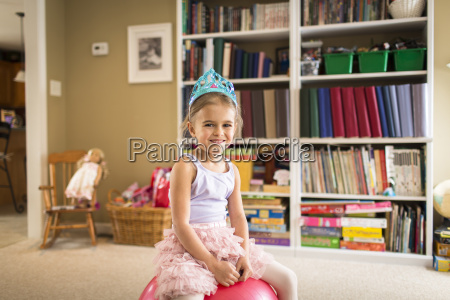 portrait of cute young girl sitting