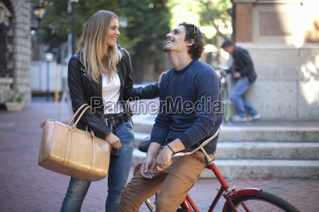 young woman with boyfriend leaning on