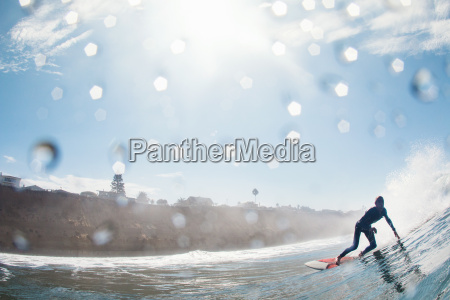 mid adult male surfer leaning into