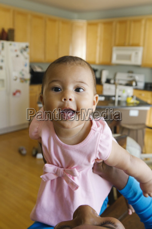 portrait of baby girl in kitchen