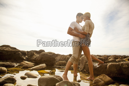 young couple standing together face to