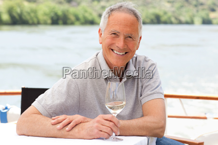 senior man with a glass of