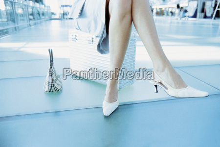 businesswoman waiting in airport terminal
