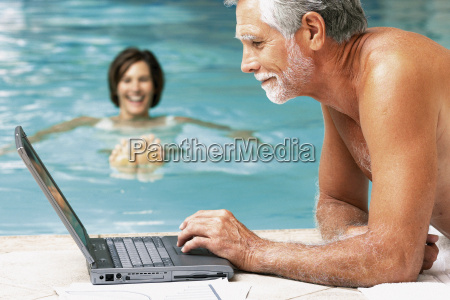 man and woman in swimming pool