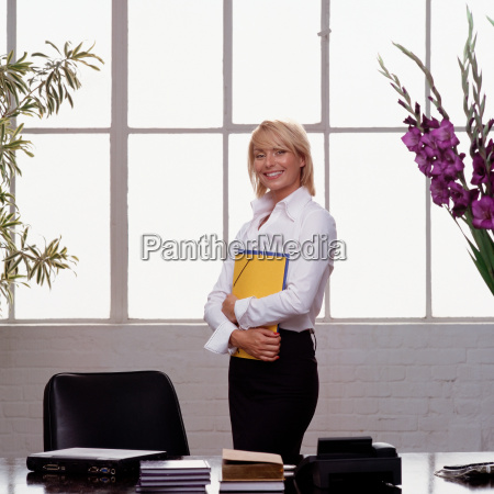 businesswoman holding folders