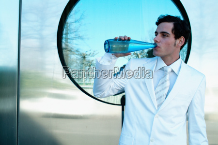 man in a white suit