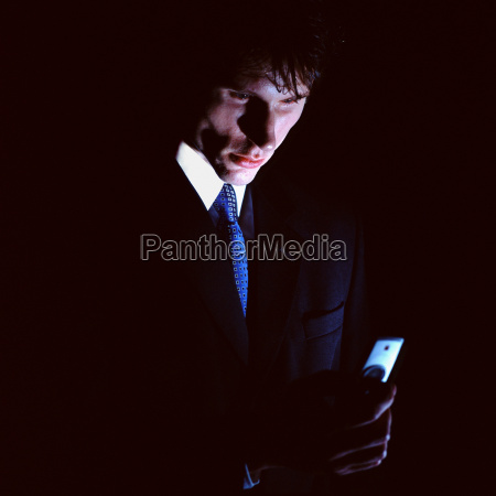 businessman with mobile phone in the