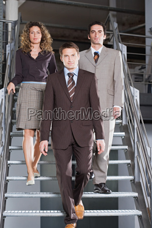 business people walking down the stairs