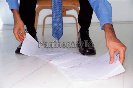 businessman looks at papers