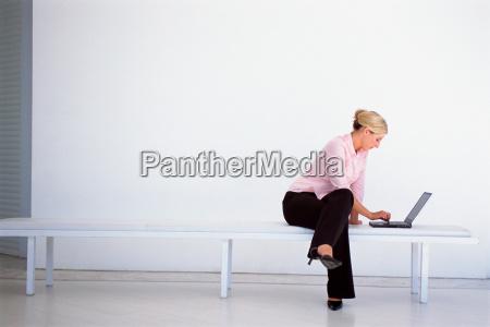 businesswoman works laptop