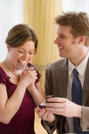 man giving diamond ring to girlfriend