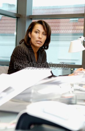businesswoman at messy desk