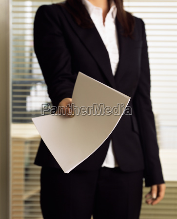 businesswoman holding a document
