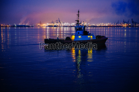 tugboat in front of harbor at