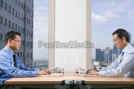 businessmen using laptop computers