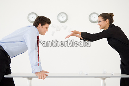 woman throwing screwed up paper at