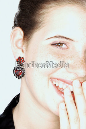 laughing woman with heart shaped earring