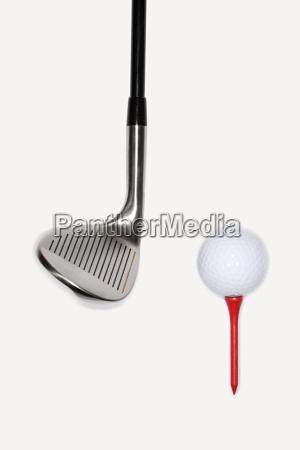 golf club with golf ball on