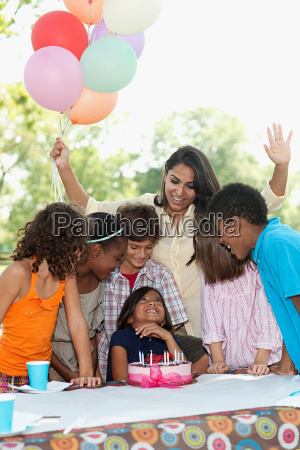 children at birthday party with birthday