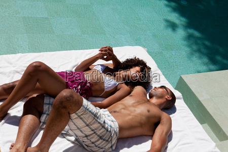 couple lying by pool