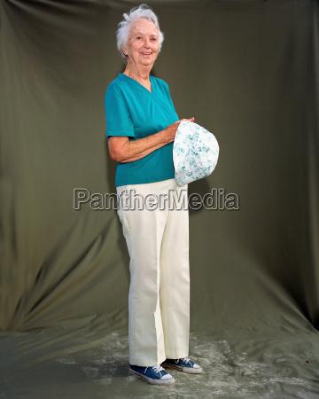 a mature woman holding a summer