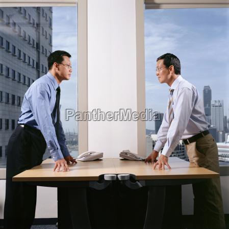 hostile looking businessmen