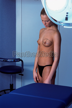 woman preparing for breast implant operation