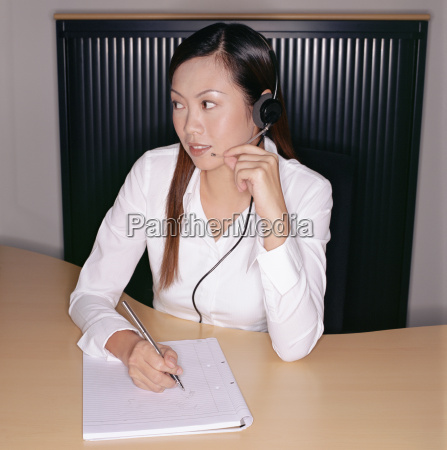 businesswoman wearing a telephone headset