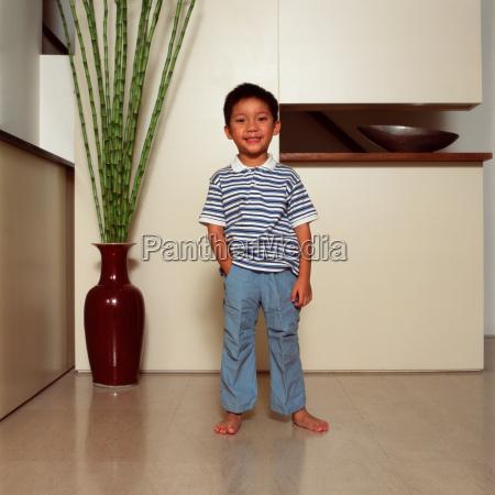 boy standing in living room
