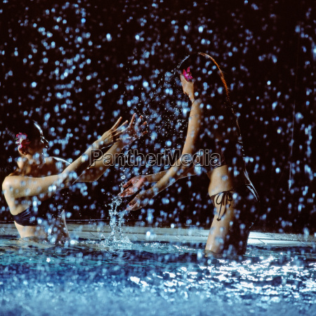 two women playing in swimming pool