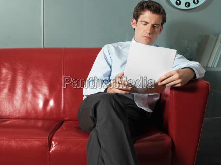 man reading paperwork