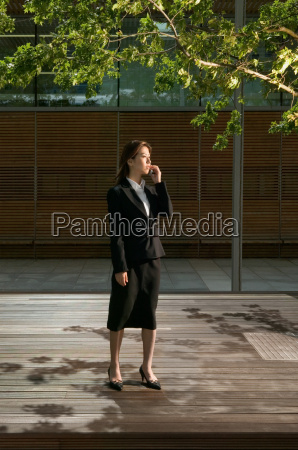 businesswoman using cellular telephone