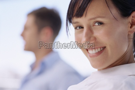 smiling woman with colleague
