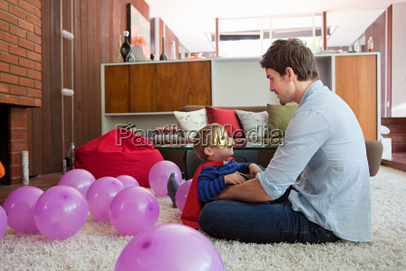 father and son playing with balloons