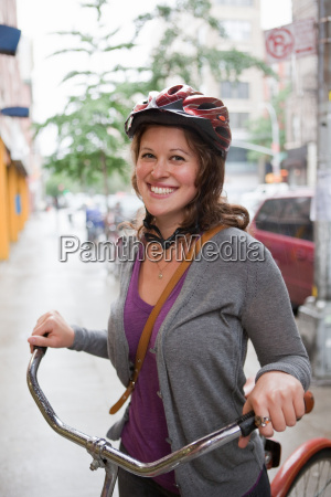 young woman wearing cycle helmet smiling