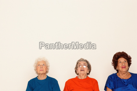 three elderly women looking up