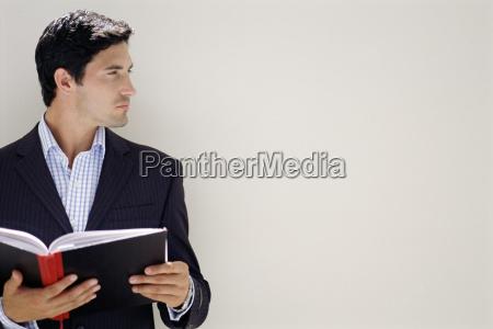 businessman holding a notebook