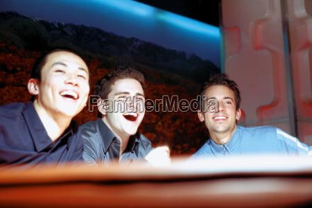 men laughing in nightclub