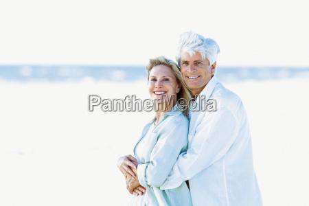 a senior couple on a beach