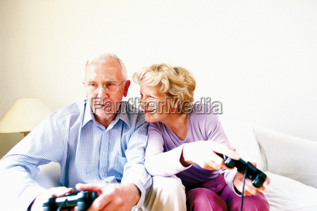 man and woman playing computer game