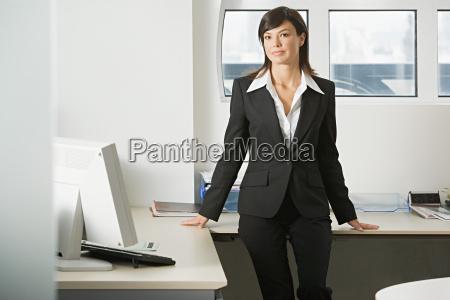 businesswoman sitting on a desk