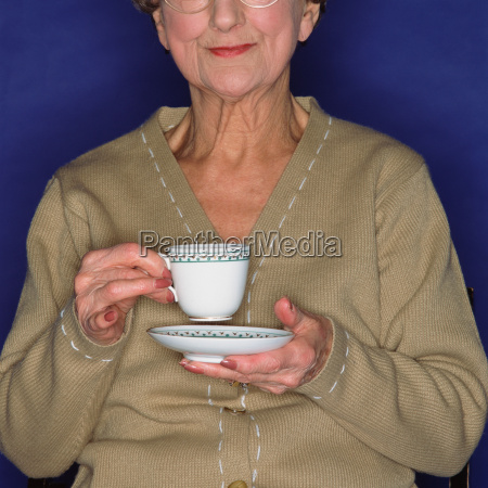 senior woman having a cup of